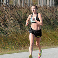 Adriana Piekarewicz runs the 16th Annual Battleship Half Marathon. (Jason A. Frizzelle)