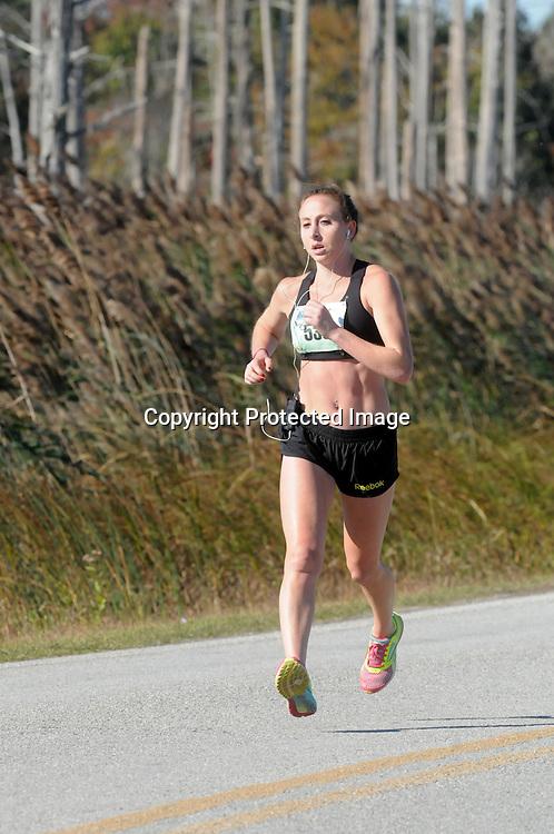 Adriana Piekarewicz runs the 16th Annual Battleship Half Marathon. (Jason A. Frizzelle)