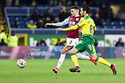 Burnley defender Matthew Lowton (2) challenged by Norwich City midfielder Mario Vrančić (8)  during the The FA Cup match between Burnley and Norwich City at Turf Moor, Burnley, England on 25 January 2020.