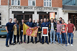 National Fire Brigades Union Strike. <br /> Members of the National Fire Brigades Union go on a 4 hour strike to highlight the dispute over planned pension scheme changes. Pictured are crew at Euston Fire Station, London, during the 4 hour strike, London, United Kingdom. Wednesday, 25th September 2013. Picture by Ben Stevens / i-Images