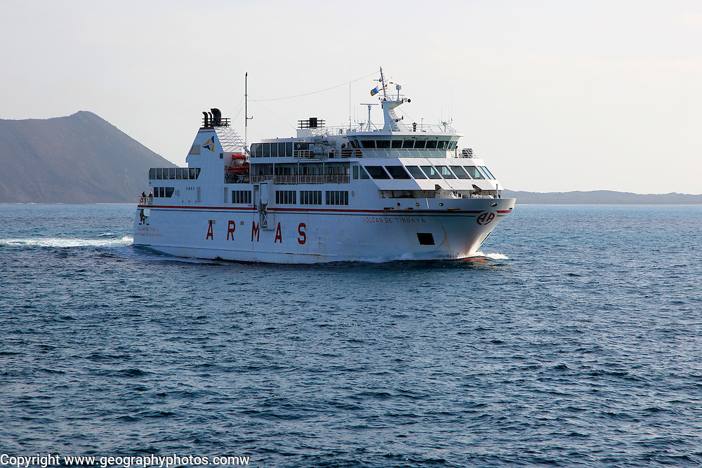 Armas ferry ship passing Los Lobos island, Corralejo, Fuerteventura, Canary Islands, Spain
