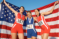 Athletes celebrating with medals and American flag
