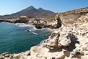 Volcanoes and fossilised sand dune rock structure, Los Escullos, Cabo de Gata natural park, Almeria, Spain