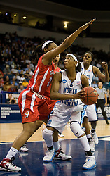 North Carolina guard/forward Rashanda McCants (32) is guarded by Georgia guard Christy Marshall (22) under the basket.  The #1 seed North Carolina Tar Heels defeated the Georgia Bulldogs 80-66 in the second round of the 2008 NCAA Women's Basketball Championship at the Ted Constant Convocation Center in Norfolk, VA on March 25, 2008.