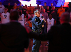 Jan 9, 2018; Morgantown, WV, USA; WVU Police Officer Carlton Smith sings the National Anthem before the game at WVU Coliseum. Mandatory Credit: Ben Queen-USA TODAY Sports