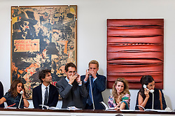 """© Licensed to London News Pictures. 07/10/2016. London, UK.   (L to R) """"Avventuroso2"""" by Mimmo Rotella sold for a hammer price of £380k (est £400-600k) and """"Forager for Plankton"""" by Salvatore Scarpitta sold for a hammer price of £1.8m (est £1-1.5m) at Sotheby's Italian and Contemporary Art evening sale in New Bond Street. Photo credit : Stephen Chung/LNP"""