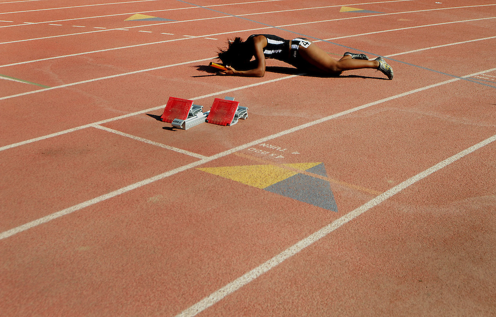 [date} 2:41:00 PM --- TRACK SPORTS SHOOTER ACADEMY 005 -- A runner lays on the track after falling during a relay race at the Ben Brown Invitational Track meet at Mount San Antonio College Saturday March 8, 2008. Photo by Daniel Berman, Sports Shooter Academy