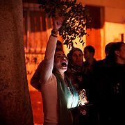A female protestor shouts anti Mohamed Morsi slogans outside the presidential palace, in central Cairo, where tens of thousands gathered to voice their anger against a planned referendum for a new islamic based constitution.