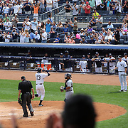 Alex Rodriguez hits a home run off Detroit Tigers pitcher Justin Verlander in front of a packed crowd at Yankee Stadium during the New York Yankees V Detroit Tigers Major League Baseball regular season baseball game at Yankee Stadium, The Bronx, New York. 11th August 2013. Photo Tim Clayton