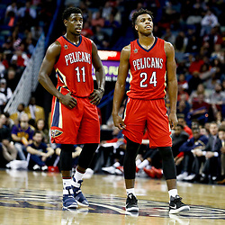 Dec 21, 2016; New Orleans, LA, USA;  New Orleans Pelicans guard Jrue Holiday (11) and guard Buddy Hield (24) against the Oklahoma City Thunder during the second half of a game at the Smoothie King Center. The Thunder defeated the Pelicans 121-110. Mandatory Credit: Derick E. Hingle-USA TODAY Sports