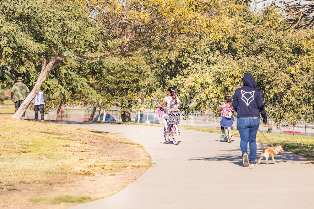 People Walking and Bike Riding at Earvin Magic Johnson Recreation Area
