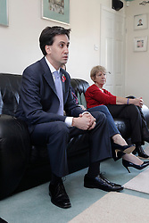 Ed Miliband MP, Leader of the Opposition talks to residents of Great Oakley in Mr & Mrs Webb's home, Corby, Northamptonshire, October 30, 2012.  Photo By Tim Scrivener / i-Images
