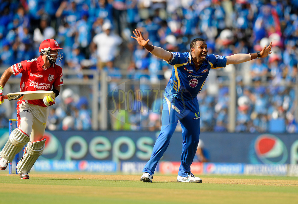 Kieron Pollard of the Mumbai Indians appeals unsuccessfully for the wicket of Glenn Maxwell of the Kings X1 Punjab during match 22 of the Pepsi Indian Premier League Season 2014 between the Mumbai Indians and the Kings XI Punjab held at the Wankhede Cricket Stadium, Mumbai, India on the 3rd May  2014<br /> <br /> Photo by Pal Pillai / IPL / SPORTZPICS<br /> <br /> <br /> <br /> Image use subject to terms and conditions which can be found here:  http://sportzpics.photoshelter.com/gallery/Pepsi-IPL-Image-terms-and-conditions/G00004VW1IVJ.gB0/C0000TScjhBM6ikg