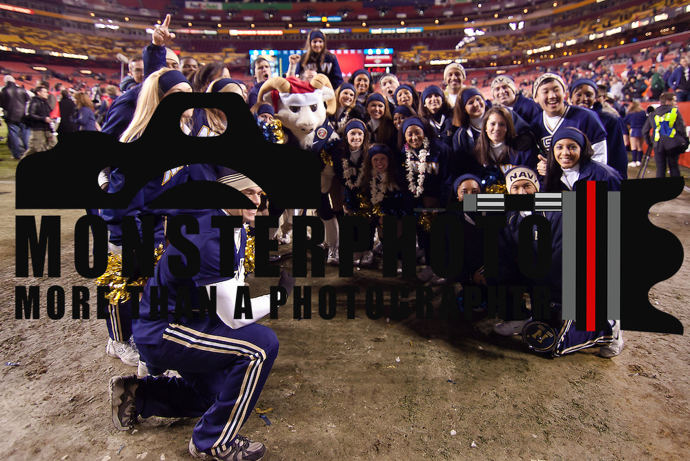 Navy cheerleaders pose with Navy Mascot Bill the Goat Saturday, Dec. 10, 2011 at Fed EX field in Landover Md. ..Navy set the tone early in the game as Navy defeats Army 31-17 in front of 82,000 at Fed EX Field in Landover Md