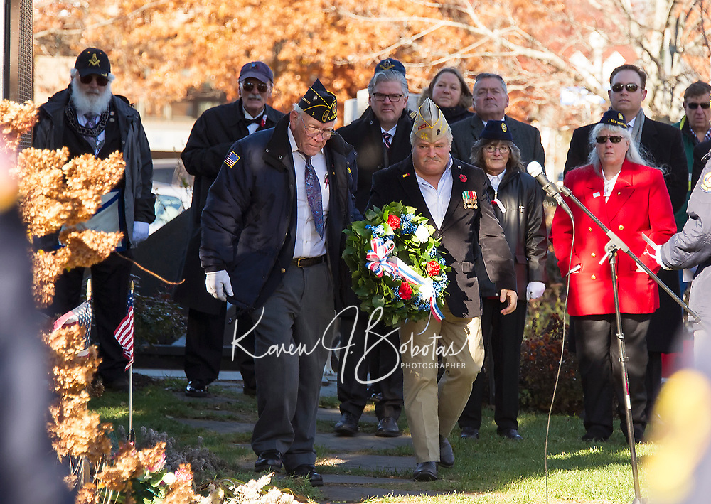 American Legion Commander Herman Chamberlain and VFW Commander Timm Grant lay a wreath to honor veterans during Sunday mornings Veteran's Day service in Laconia.  (Karen Bobotas/for the Laconia Daily Sun)