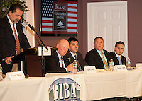 Democrats David Huot, Charles Smith, Chad Vaillancourt and Robert Fisher with Moderator Ed Engler during the Laconia debate at the Beane Conference Center Monday evening.  (Karen Bobotas/for the Laconia Daily Sun)