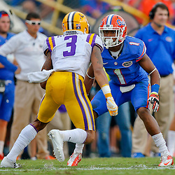 Oct 12, 2013; Baton Rouge, LA, USA; Florida Gators defensive back Vernon Hargreaves III (1) against LSU Tigers wide receiver Odell Beckham (3) during the second half of a game at Tiger Stadium. LSU defeated Florida 17-6. Mandatory Credit: Derick E. Hingle-USA TODAY Sports
