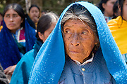 "26 APRIL 2005 - SAN CRISTOBAL DE LAS CASAS, CHIAPAS, MEXICO: A woman goes to a Catholic mass in the Chumalan Indian community of Bautista Chico near San Cristobal de las Casas, Chiapas, Mexico. The Catholic Church in the Chiapas highlands is facing a threat from evangelical Protestant churches, which are experiencing explosive growth, and from ""traditionalist"" Catholic churches, which are not affiliated with the San Cristobal diocese and are controlled by local politicians and powerful indigenous leaders affiliated with the politicians. The traditionalists burn down churches and chapels affiliated with the diocese, threaten the priests and put indigenous men who worship with the diocese in jail.  PHOTO BY JACK KURTZ"