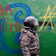KIEV, UKRAINE - February 20, 2014: An anti-government protestors takes cover behind newly build barricades at the frontline where violent clashes were happening between protestors and riot police outside Independence Square in central Kiev. The riot police responded to the advance with gunfire that, according to the opposition, killed at least 70 and as many as 100 people. The drastic escalation of the three-month-old Ukraine crisis left the country reeling from the most lethal violence in decades. CREDIT: Paulo Nunes dos Santos