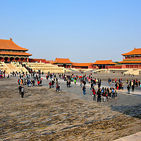 Hall of Supreme Harmony Courtyard at Forbidden City in Beijing, China <br /> The largest open square in the Outer Court awaits you after leaving the Gate of Supreme Harmony. It is surrounded by eight structures with the Hall of Supreme Harmony in the center. From right to left are: Belvedere of Embodying Benevolence (Tiren ge), the Left-wing Gate (Zuo yimen) and Middle Left Gate (Zhongzuo men). These two gates lead to the courtyard of the Middle Harmony Pavilion. Surveying this view is the moment most people begin to recognize the magnitude of the Forbidden City. The former Imperial City consists of 90 palaces, 980 buildings and an incredible 8,704 rooms.