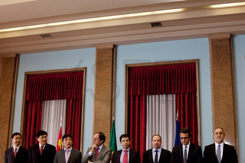 Cao Guangjing, (third from left) President of Three Gorges electric company,Paulo Portas, portuguese Minister for Foreign Affairs,  Vitor Gaspar, portuguese Ministry of Finances, &Aacute;lvaro Santos Pereira, portuguese Minister of Economy and Employment and Ant&oacute;nio Mexia, chairman of EDP and Joaquim Reis chairman of Parp&uacute;blica.<br /> The president of China Three Gorges electric company, Cao Guangjing; the chairman of the board of Parp&uacute;blica, Joaquim Reis, and Ant&oacute;nio Mexia, chairman of the Board of EDP signed an agreement that gives the first formal step for the acquisition of a state share of 21.35% in the EDP, the portuguese electric company.