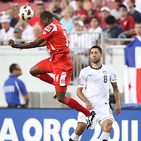 Panama defender  Eduardo Dasent (14) heads the ball past USA midfielder Clint Dempsey (8)during a  CONCACAF Gold Cup soccer match between the United States and Panama on Saturday, June 11, 2011, at Raymond James Stadium in Tampa, Fla. (AP Photo/Alex Menendez)