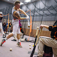 Gallup Bengal Isaiah Malcolm and his teammates hit from tees during practice at Gallup High School Wednesday.