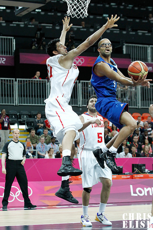 04 August 2012: France Tony Parker goes for the reverse layup past Tunisia Mokhtar Ghayaza during 73-69 Team France victory over Team Tunisia, during the men's basketball preliminary, at the Basketball Arena, in London, Great Britain.