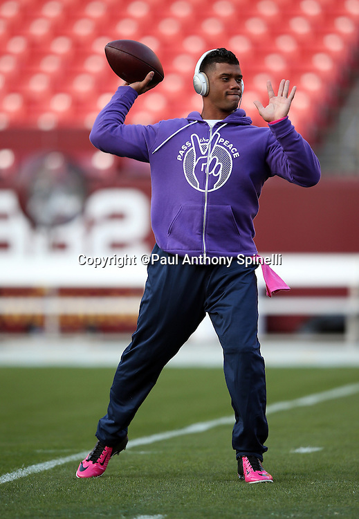 Seattle Seahawks quarterback Russell Wilson (3) throws a pregame pass while warming up before the NFL week 5 regular season football game against the Washington Redskins on Monday, Oct. 6, 2014 in Landover, Md. The Seahawks won the game 27-17. ©Paul Anthony Spinelli