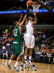 Virginia forward Mike Scott (32) shoots a layup against USF.  The Virginia Cavaliers defeated the South Florida Bulls 77-75 at the University of Virginia's John Paul Jones Arena in Charlottesville, VA on November 19, 2008.