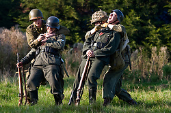 US Airborne troops sneak up on two German sentries during a small scale Skirmish at the Northallerton Wartime weekend charity fundraiser for Help for Heros and Ben Hyde Memorial Trust 9th &10th Ocober 2010 .Images <br />