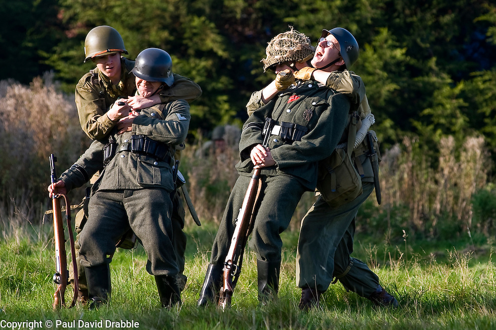 US Airborne troops sneak up on two German sentries during a small scale Skirmish at the Northallerton Wartime weekend charity fundraiser for Help for Heros and Ben Hyde Memorial Trust 9th &amp;10th Ocober 2010 .Images <br />