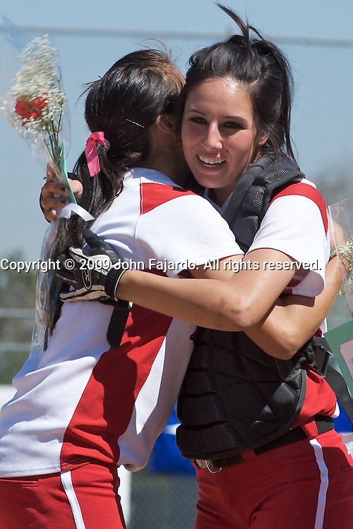 Alyssa Belmontes receives a hug and flowers from a teammate during pregame festivities against Mt. SAC at the LAC softball field on Tuesday April 21, 2009.  The Vikings lose the final regular season home game to Mt. SAC 5-1.
