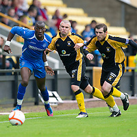 East Fife v St Johnstone...11.07.12  Pre-Season Friendly<br /> New signing Gregory Tade fends off Darren Smith and Craig Johnstone<br /> Picture by Graeme Hart.<br /> Copyright Perthshire Picture Agency<br /> Tel: 01738 623350  Mobile: 07990 594431