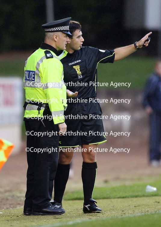 St Johnstone v Clyde....27.10.07<br /> Ref Euan Norris hands over something thrown on the pitch to the police<br /> Picture by Graeme Hart.<br /> Copyright Perthshire Picture Agency<br /> Tel: 01738 623350  Mobile: 07990 594431