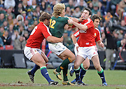 Wynand Olivier of the Springboks is tackled by Stephen Jones and Ross Ford of the Lions. <br /> Rugby - 090704 - Springboks vs British&Irish Lions - Coca-Cola Park - Johannesburg - South Africa. The Lions won the third test 28-9 but lost the series 2-1 to the Springboks.<br /> Photographer : Anton de Villiers / SASPA
