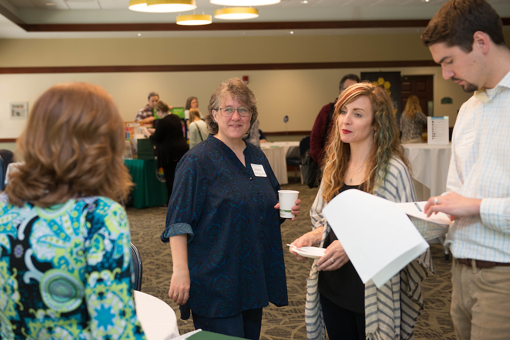 Jill Bateman, Web Administrator, left, Colleen Carow, Senior Director of Communications, center, and Pete Shooner, Associate Director of Communications, right, all from the Russ College of Engineering and Technology, at the Campus Communicator Network Expo in Nelson Commons on Wednesday, May 11, 2016. © Ohio University / Photo by Kaitlin Owens