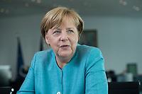 23 AUG 2017, BERLIN/GERMANY:<br /> Angela Merkel, CDU, Bundeskanzlerin, waehrend einem Interview, in Ihrem Buero, Bundeskanzleramt<br /> IMAGE: 20170823-02-010<br /> KEYWORDS: B&uuml;ro