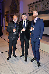 Left to right, GRAHAM NORTON, EDWARD TAYLOR and ANDREW SMITH at a private view of Alexander McQueen's Savage Beauty exhibition hosted by Samsung BlueHouse at the V&A, London on 30th March 2015.