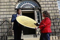 Scottish Labour deputy leader Anas Sarwar and credit union leader worker Alison Dowling deliver a giant pound coin to Bute House. The First Minister's official residence, to highlight uncertainty over what currency an independent Scotland would use.<br /> <br /> Pako Mera/Universal News And Sport (Europe) 07/08/2014