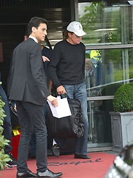 Kim's driver Gary Madar with Bruce Jenner arriving in Paris, Bourget, after wedding ceremony in Florence. Kardashian family and guests arriving at the Bourget airport, after wedding ceremony of kim Kardashian and Kanye West in Florence. Bourget, near Paris, France, on May 25, 2014. Kim's drivers Mickael Madar and his brother Gary Madar are the main suspects three months after the Kim Kardashian' robbery in a mansion in Paris during Fashion Week, the police conducted an extensive dragnet. 16 people aged 23-73 years arrested at 6am this morning in Paris and suburb. Photo by ABACAPRESS.COM