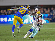 Jan 12, 2019; Los Angeles, CA, USA;  Dallas Cowboys quarterback Dak Prescott (4) looks to avoid the tackle from Los Angeles Rams offensive linebacker Samson Ebukam (50) during an NFL divisional playoff game at the Los Angeles Coliseum. The Rams beat the Cowboys 30-22. (Kim Hukari/Image of Sport)