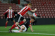 Southampton Harry Reed tackles Manchester United U21 Josh Harrop during the Barclays U21 Premier League match between U21 Southampton and U21 Manchester United at the St Mary's Stadium, Southampton, England on 25 April 2016. Photo by Phil Duncan.