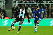 Allan Saint-Maximin (#10) of Newcastle United controls the ball under pressure from Reece James (#24) of Chelsea during the Premier League match between Newcastle United and Chelsea at St. James's Park, Newcastle, England on 18 January 2020.