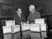 14/09/1960<br /> 09/14/1960<br /> 14 September 1960<br /> Gift radios for troops in the Congo at McKee Barracks, Dublin. Pic shows: Mr A.J.W. van Agt (Managing director of Philips Ireland Ltd.) presenting the radios to Colonel T.J. Gray Director of Plans and Operations, Chief of Staff Branch, who received the presentation on behalf of the army. When he presented the 12 tropicalized transistor, portable Philips radios as a gift from Philips Ireland Ltd. for the Irish troops in the Congo, Mr van Agt said he hoped the news they received on the sets would always be good news.