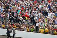 24 May 2009: 3 Helio Castroneves climbs the fence to celebrate his victory at Indianapolis 500. Indianapolis Motor Speedway Indianapolis, Indiana.