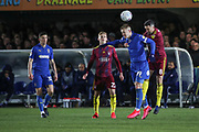 AFC Wimbledon striker Joe Pigott (39) battles for possession with Ipswich Town midfielder Cole Skuse (8) during the EFL Sky Bet League 1 match between AFC Wimbledon and Ipswich Town at the Cherry Red Records Stadium, Kingston, England on 11 February 2020.