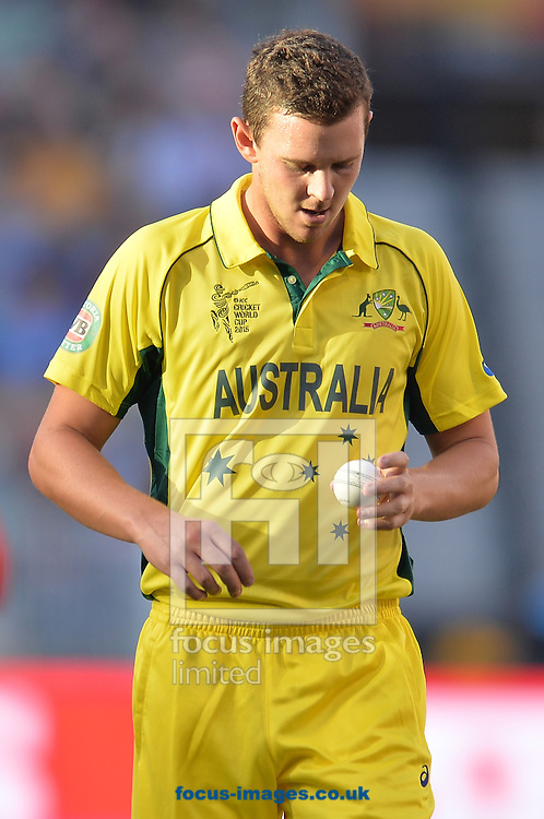 Josh Hazlewood of Australia looks at the ball during the 2015 ICC Cricket World Cup match at Melbourne Cricket Ground, Melbourne<br /> Picture by Frank Khamees/Focus Images Ltd +61 431 119 134<br /> 14/02/2015