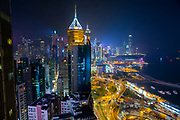 A view of the glittering Hong Kong skyline overlooking Causeway Bay, Hong Kong. The tall building with the spike on top is the Central Plaza building, which is a skyscraper with a light installation. (photo by Andrew Aitchison / In pictures via Getty Images)