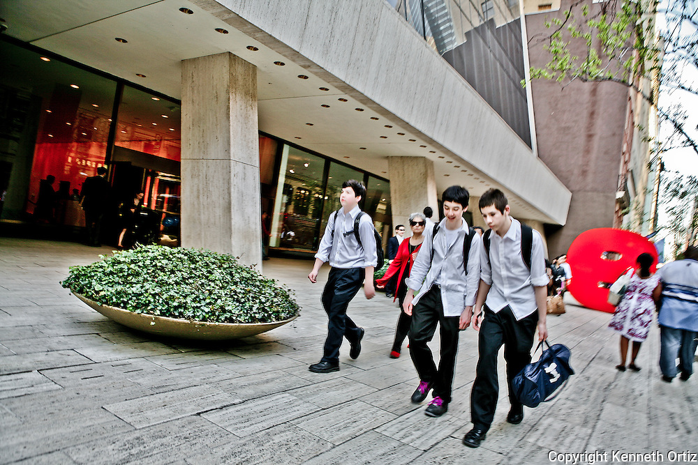 Young boys walking down 57th in Manhattan after school.